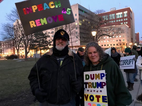 Pat and Judi Campeau attended a pro-impeachment rally outside the state Capitol in Lansing Tuesday