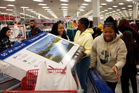 Consumer spending will be key in 2020 to steer clear of a U.S. recession. File photo: Shoppers from right Brittney McFaddenn, Rayneisha Yancey and Ja'shay Stagg bring a new television in their cart during Black Friday shopping at Target in Carson, Calif.,on Friday, Nov. 29, 2019. (Dania Maxwell/Los Angeles Times/TNS)