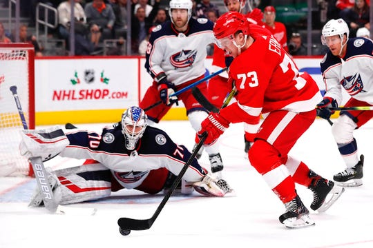 Detroit Red Wings left wing Adam Erne tries to score on Columbus Blue Jackets goaltender Joonas Korpisalo in the second period at Little Caesars Arena, Tuesday, Dec. 17, 2019, in Detroit.