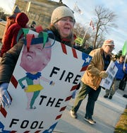 Pro-impeachment protesters attend a rally in Adrian, Tuesday, Dec. 17, 2019.