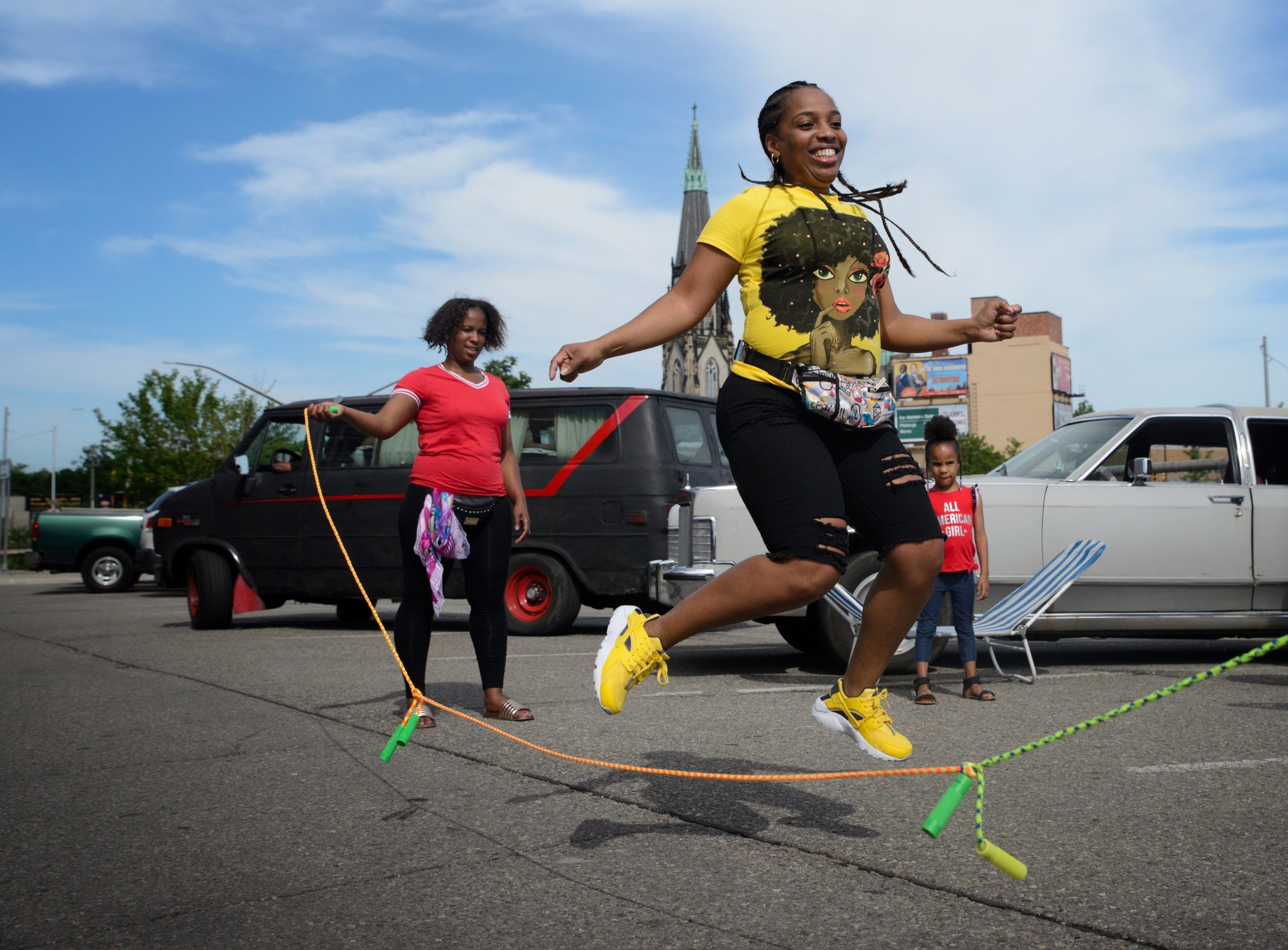 Mina Powell of Southfield skips rope at Eastern Market before the 2018 Ford Fireworks in Detroit on Monday, June 25, 2018.