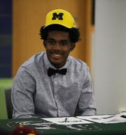 West Bloomfield senior Makari Paige signed his letter of intent to play football at Michigan, Dec. 18, 2019 at West Bloomfield high school.