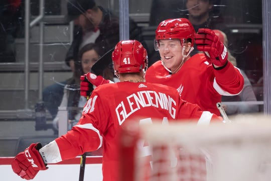 Detroit left wing Adam Erne and center Luke Glendening celebrate after Erne scored his second goal of the game in the first period.