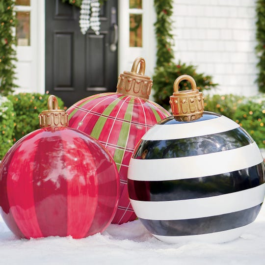 A dramatic way to dress the front of the home, these supersized ornaments from Grandin Road are elegantly hand-painted in bold, graphic designs, like giant glossy versions of glass Christmas tree ornaments. The small oversized yard ornament in red stripe (slightly tilted) is 24 inches in diameter, 29 inches tall; medium black and white is 27 inches, 34 inches tall; large red plaid (also slightly tilted) is 30 inches, 38 inches tall.