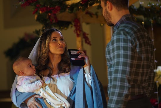 "Child Protective Services agent Alison Hensley (Monica Knox), dressed as Mary during a nativity play, finds an abandoned baby in a manger. She flashes her creds to police officer Brock Layson (Michael Morrone) in ""Baby in a Manger."""