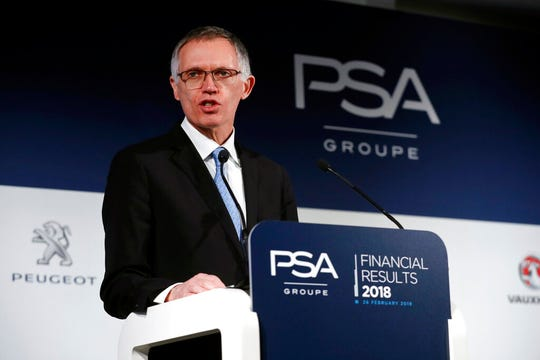 PSA Peugeot Citroen Chief Executive Carlos Tavares delivers a speech during the presentation of the company's 2018 full year results, in Rueil Malmaison, west of Paris, Tuesday, Feb. 26, 2019.