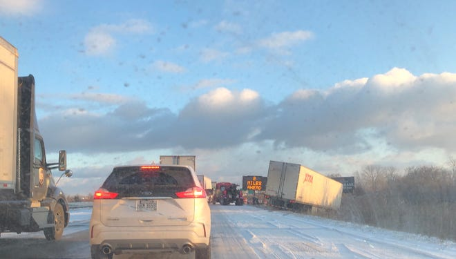 Multiple cars and trucks had spun off the roadway on I-75 in Monroe County near Exit 11, LaPlaisance.