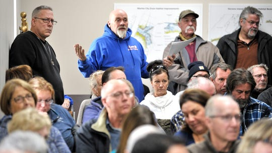 About 200 islanders jammed the township hall last week to discuss a $2 round-trip rate increase and other concerns about Champion's Auto Ferry following the collapse of the ferry's dock.