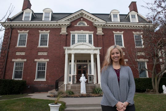 Program manager Amy Kinner stands outside The Jefferson House, a Capuchin drug and alcohol rehab program.