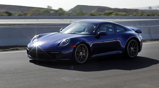 The 2020 Porsche 911 Carrera 4S is powered by a 3-liter, 6-cylinder, twin-turbo engine that makes 443 horsepower and 390 pound-feet of torque.
