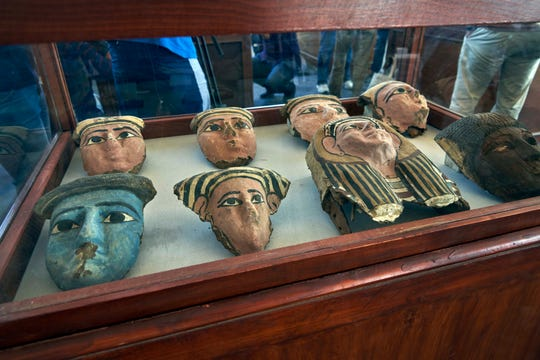 Wooden and clay mummies masks are displayed in Saqqara, south Giza, Egypt.