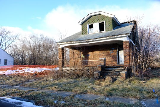 The fire-damaged home that was supposed to be demolished stands at 14461 Alma Avenue.