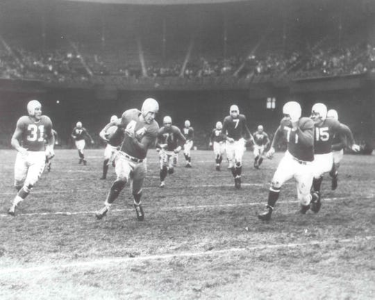 Don Doll, pictured in a game at Tiger Stadium, played for the Lions for four of his six NFL seasons.