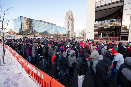 Thousands of people wait in line to get inside Kellogg Arena for a rally for President Donald Trump, in Battle Creek, December 18, 2019.
