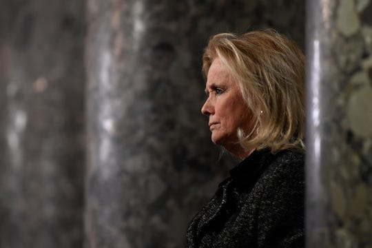 Rep. Debbie Dingell, D-Mich, speaks to reporters on Capitol Hill in Washington, Wednesday, Dec. 18, 2019.