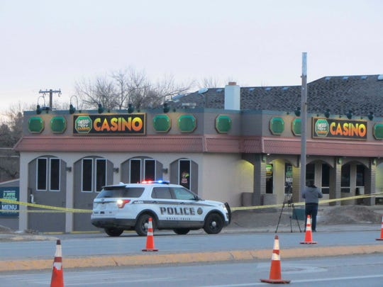 Police closed two westbound lanes of 10th Avenue South Tuesday, Dec. 17, 2019, after a triple homicide at the Emerald City Casino in Great Falls, Mont.