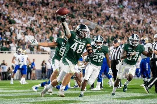 Michigan State defensive end Kenny Willekes, celebrating a touchdown in the opener against Tulsa, had nine sacks this season.