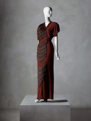 "An Adrian gown from the 1940s that actor Eddie Albert bought for his wife, in the exhibition ""In Pursuit of Fashion: The Sandy Schreier Collection"" at New York's Metropolitan Museum."