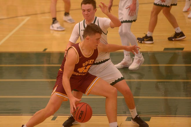 Rocky Mountain basketball player Peter Krohn battles for space during a game against Fossil Ridge on Tuesday, Dec. 17, 2019. Fossil Ridge won 74-58.