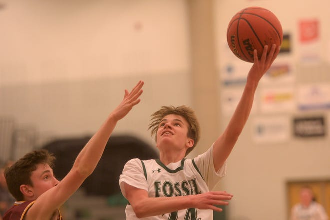Fossil Ridge basketball player Mike Cover shoots during a game against Rocky Mountain on Tuesday, Dec. 17, 2019. Fossil Ridge won 74-58.