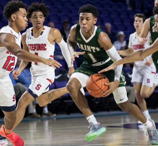Kennedy Chandler of Briarcrest Christian brings the ball up the court against Archbishop Stepinac in the opening game of the 2019 City of Palms Classic on Wednesday, Dec. 18, 2019, in Fort Myers. Stepinac won the game 69-62.