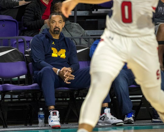 Michigan coach Juwan Howard watches the Archbishop Stepinac and Briarcrest Christian game during the 2019 City of Palms Classic on Wednesday, Dec. 18, 2019, in Fort Myers. Stepinac won the game 69-62.
