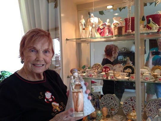 Lotte Phalen, 93, holds the angel figurine her future husband bought for his mother in Hamburg, Germany, in 1950.