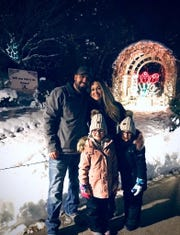 "Steve Lessuise, along with his 7-year-old twin daughters, Ava and Emma, proposed to Kelsea Gallagher by the ""Will You Marry Me?"" light on Dec. 6 at Green Bay Botanical Garden's WPS Garden of Lights."