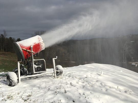 A snow making machine flings snow onto a hill at Winter Park in Kewaunee.