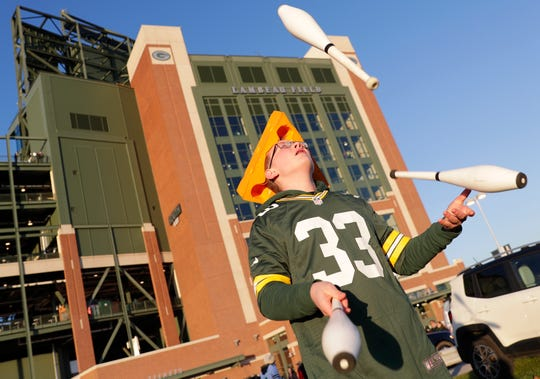 Benjamin Sneesby, 14, of Minneapolis juggles outside Lambeau Field before the Green Bay Packers game against the Detroit Lions on Oct. 14, 2019, in Green Bay, Wis.