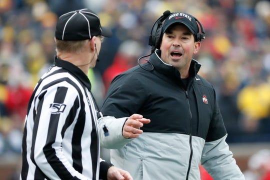 Nov 30, 2019; Ann Arbor, MI, USA; Ohio State Buckeyes head coach Ryan Day talks to the referee in the first half against the Michigan Wolverines at Michigan Stadium. Mandatory Credit: Rick Osentoski-USA TODAY Sports