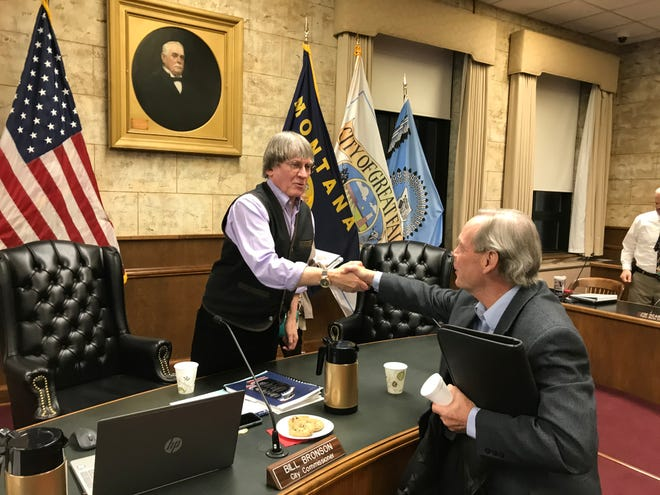 In January, Public Works Director Jim Rearden, right, says good by to outgoing City Commissioner Bill Bronson. Rearden notified City Manager Greg Doyon he was retiring Jan. 21, and Doyon made the announcement at a City Commission meeting Tuesday.