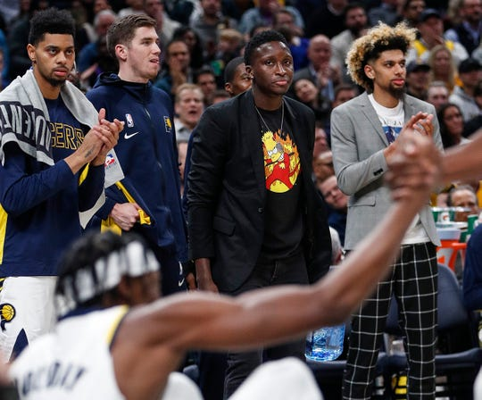Indiana Pacers guard Victor Oladipo (4) watches a teammate helped off the floor at Bankers Life Fieldhouse, Indianapolis, Saturday, Dec. 17, 2019. The Indiana Pacers defeated Los Angeles Lakers, 105-102.