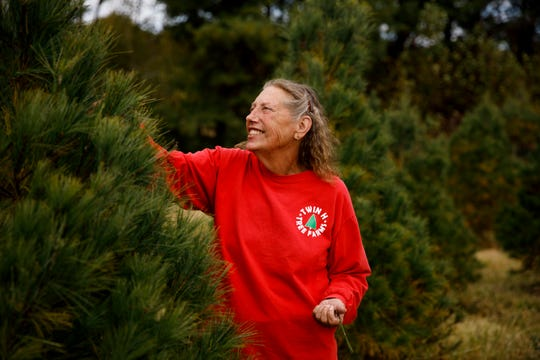 Jeanne Hopwood at her Christmas tree farm, Twin H Tree Farms, near Bloomington in October.