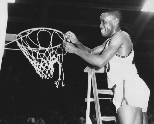 Ralph Taylor cuts down the nets after the big win.