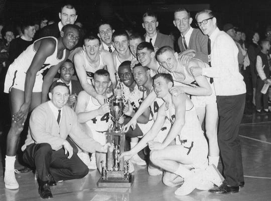 A happy Washington High team with its 1965 state trophy.