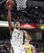 Indiana Pacers guard Malcolm Brogdon (7) reaches for a layup against the Los Angeles Lakers during the first half at Bankers Life Fieldhouse, Indianapolis, Saturday, Dec. 17, 2019.