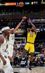 Los Angeles Lakers forward LeBron James (23) attempts three points in the final seconds of the game at Bankers Life Fieldhouse, Indianapolis, Saturday, Dec. 17, 2019. The Indiana Pacers defeated Los Angeles Lakers, 105-102.