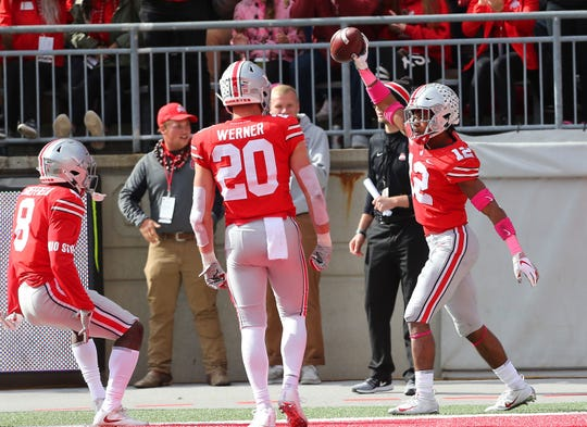 Isaiah Pryor (12) is transferring from Ohio State to Notre Dame. He showed off an interception against Minnesota.