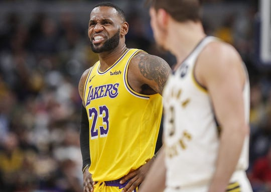 Los Angeles Lakers forward LeBron James (23) stands on the court during a free-throw during the second half at Bankers Life Fieldhouse, Indianapolis, Saturday, Dec. 17, 2019.