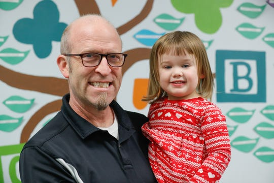Executive Director of St. Nicholas Early Learning, Inc. , Dave Sandrick holds little Vera Cusimano in their play space, Wednesday, Dec. 18, 2019.