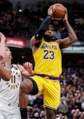 Los Angeles Lakers forward LeBron James (23) passes the ball at Bankers Life Fieldhouse, Indianapolis, Saturday, Dec. 17, 2019. The Indiana Pacers defeated Los Angeles Lakers, 105-102.