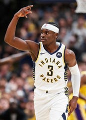 Indiana Pacers guard Aaron Holiday (3) holds up three fingers after scoring a three point shot at Bankers Life Fieldhouse, Indianapolis, Saturday, Dec. 17, 2019. The Indiana Pacers defeated Los Angeles Lakers, 105-102.