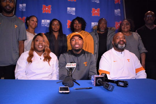 Madison Central quarterback Jimmy Holiday, center, signed with the University of Tennessee on Wednesday during the early signing period.