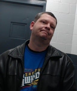 Michael Burks, 39, son of Selmer Police Chief Neal Burks, was arrested Wednesday on two counts of tampering with evidence and one count of theft.