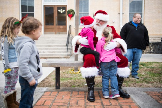 Blount County Mayor Ed Mitchell, dressed as Santa, greets children outside the Blount County Court House Tuesday, Dec. 3, 2019.