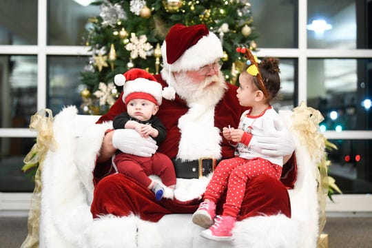 Cousins Noah Geary, 4 months, and Brooklyn George, 2, visit with Blount County Mayor Ed Mitchell dressed as Santa, at the Blount County Court House Tuesday, Dec. 3, 2019.