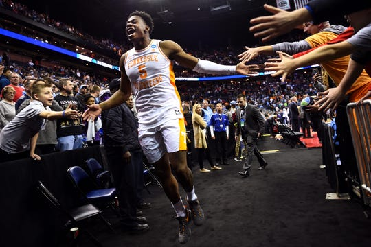 Tennessee guard Admiral Schofield (5) celebrates the overtime win over the Iowa Hawkeyes in the second round of the NCAA Tournament at Nationwide Arena in Columbus, Ohio, Sunday, March 24, 2019.
