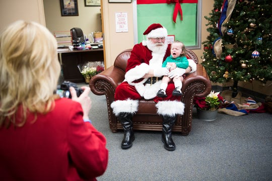 22-month-old Colt Abner Speed cries in the lap of Blount County Mayor Ed Mitchell, dressed as Santa, in his office Tuesday, Dec. 3, 2019. Mitchell has played Santa for over a decade.