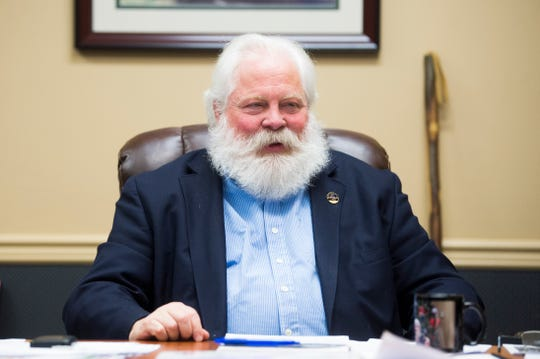 Blount County Mayor Ed Mitchell is seen at his desk in his office in Maryville, Tuesday, Dec. 3, 2019. Mitchell has played Santa for over a decade.